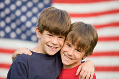 Brothers Hugging. In Front of American Flag stock photo
