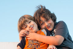 Brothers hugging at sunset. In Cape Cod royalty free stock images