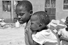 Brothers In The Kampala Slums. KAMPALA, UGANDA, AFRICA - CIRCA JANUARY 2009:  Unidentified brother circa January 2009 in the slums of Kampala, Uganda, Africa Stock Images