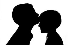 Brothers kissing. Backlighting with White background Royalty Free Stock Photography