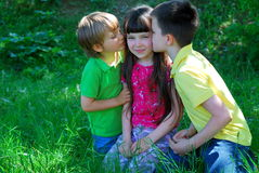 Brothers Kissing Their Sister Stock Photos