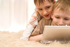 Brothers  with laptop Stock Image