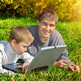 Brothers with Laptop Stock Photo