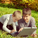 Brothers with Laptop Royalty Free Stock Image