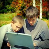 Brothers with Laptop Stock Photography