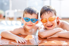 Brothers laughing in pool Royalty Free Stock Photo