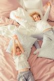 Brothers laying on the bed royalty free stock images