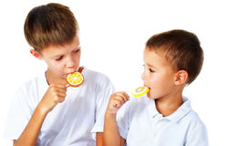 Brothers with lollipops Stock Image