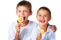 Brothers with lollipops Stock Photos