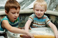 Brothers making christmas cookies. Two young brothers making christmas gingerbread cookies Royalty Free Stock Photography