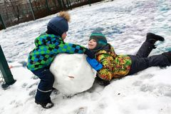 Brothers making snowman Royalty Free Stock Photo