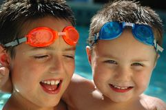 Brothers in matching goggles stock images