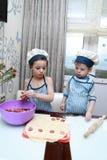 Brothers mold dumplings Royalty Free Stock Photos