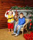 Brothers near Christmas tree Stock Images