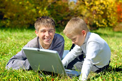 Brothers with notebook Royalty Free Stock Images