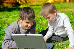 Brothers with notebook Royalty Free Stock Image