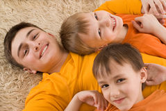Brothers in orange shirts Royalty Free Stock Photos