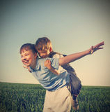 Brothers outdoors happy play. Two brothers outdoors happy play Royalty Free Stock Image