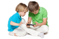 Brothers plaing with a new gadget Stock Photography