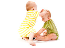 Brothers playing. Two brothers playing, isolated, over white Royalty Free Stock Photos