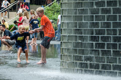 Brothers playing in the crown fountain Stock Image