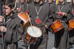 Brothers playing drums in the procession Stock Images