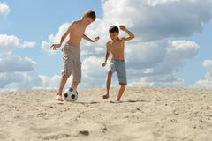Brothers playing football Royalty Free Stock Image