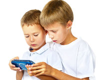 Brothers playing handheld game console Royalty Free Stock Photo