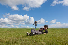 Brothers playing in the meadow. Stock Images