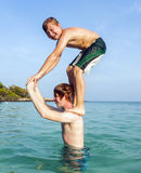 Brothers playing piggyback Royalty Free Stock Photos