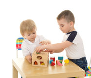 Brothers playing in the puzzle Royalty Free Stock Image
