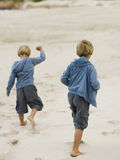 Brothers playing on the sand. royalty free stock photos