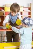Brothers playing shopping Royalty Free Stock Image