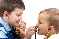 Brothers Playing With Stethoscopes Royalty Free Stock Photos