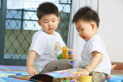 Brothers playing together Royalty Free Stock Images