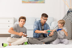 Brothers playing video games Royalty Free Stock Photos