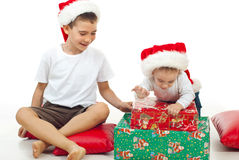 Brothers playing with Xmas gifts Royalty Free Stock Photos