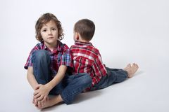 Brothers portrait - complicated relationship. Complicated brothers relationship - brothers portrait Stock Photo