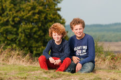 Brothers. Portrait of two brothers on a sunny autumn afternoon on the dutch moors (Ginkelse heide Stock Photo