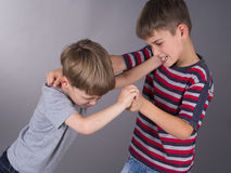 Brothers in a quarrel during learning stock images