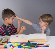 Brothers in a quarrel during learning royalty free stock photos