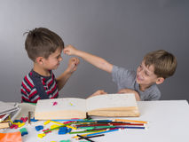 Brothers in a quarrel during learning Royalty Free Stock Images