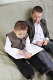 Brothers reading book Stock Image