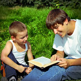 Brothers reads a Book Stock Image