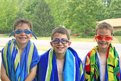 Brothers Ready for the Pool. Boys wearing both Goggles and Beach Towels Royalty Free Stock Photo