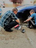 Brothers are repairing car royalty free stock images