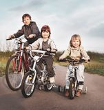 Brothers ride on bikes. The brothers ride on bikes royalty free stock photo