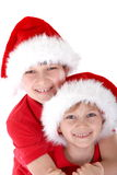 Brothers with Santa Caps  Royalty Free Stock Image