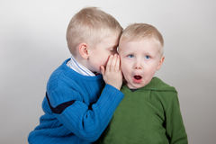 Brothers share a secret Royalty Free Stock Photo