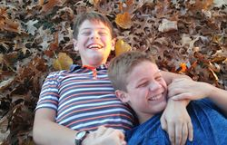 Brothers sharing a laugh in the fall Stock Image